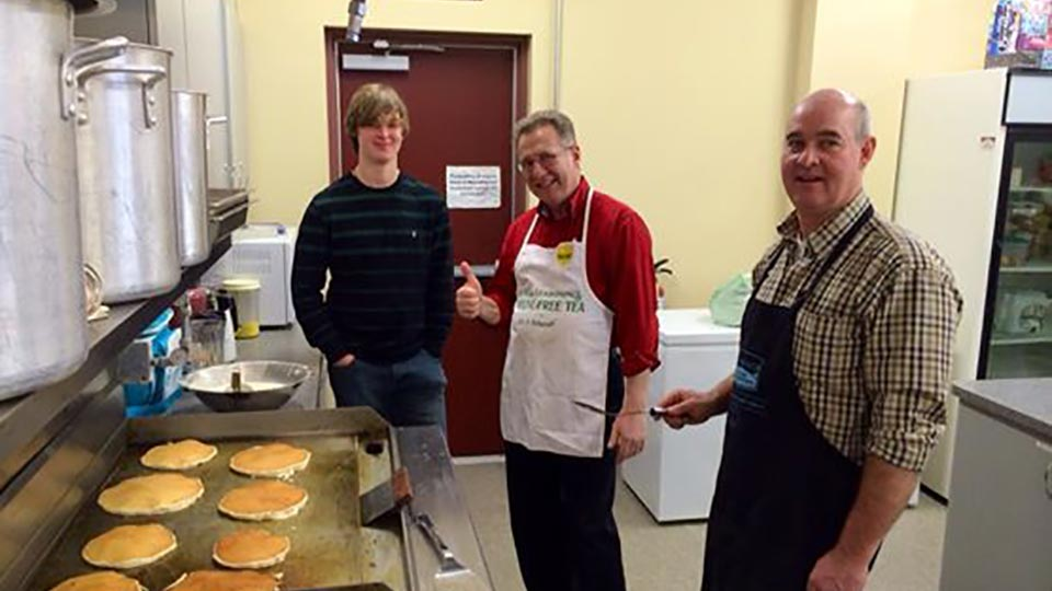 Cooking Pancakes in the Church Kitchen